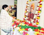 West Bengal CM Mamta Banerjee pays her tribute to Swamiji in Writers Buildings on 11-01-2012.