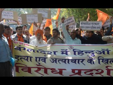 Activists from The Bajrang Dal and Visva Hindu Parishad (VHP) shout anti-Bangladesh slogans in New Delhi on March 6, 2013, during a protest against recent attacks against minority Hindus in Bangladesh. Bangladesh's main opposition leader Khaleda Zia has condemned recent attacks on Hindus in different parts of the country allegedly by activists of fundamentalist Jamaat-e-Islami, demandING punishment to perpetrators of the attacks. AFP PHOTO/RAVEENDRAN (Photo credit should read RAVEENDRAN/AFP/Getty Images) 2013 AFP