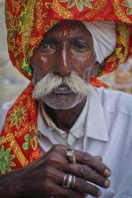 A Hindu devotee holds smokes a bidi after arriving at Shri Hinglaj Mata Temple in Pakistan