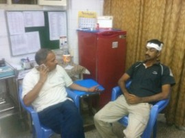 A Karyakarta at Hospital with minor injuries explaining the details