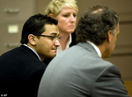 Guilty: Mr Murtaza, left, listens to the verdicts between defense attorneys Julie Swain, center, and Doug Myers, right