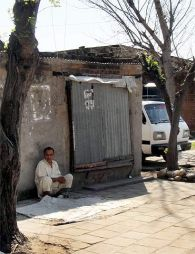 A man sits by a shop at a camp for Kashmiri migrants in Jammu Photographs: Archana Masih/Rediff.com