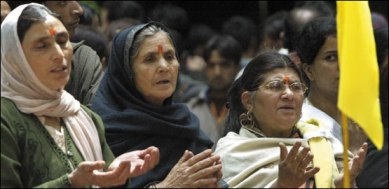 Displaced Kashmiri Pandit women pray for peace and an early return home at an annual Hindu festival: BBC.