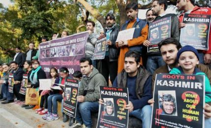 Members of Roots In Kashmir a Kashmiri Pandit Group campaigning for restoration of human rights and dignity in Kashnmir during a protest to mark the Kashmiri Pandit Exodus day and the 24th anniversary of their forced exile in New Delhi on Sunday. PTI