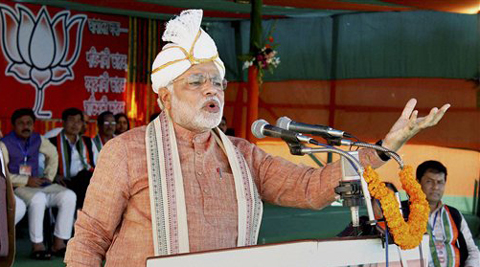 "BJP Prime Ministerial candidate Narendra Modi addressing ""Barak Bikash Samabesh"" rally at Ramnagar in Silchar, Assam on Saturday."
