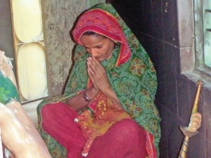 A Hindu woman prays inside the Kali Mata temple in Hyderabad. The Hanuman temple desecrated on Friday is located in the same compound. PHOTO: INP