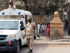 Rangers stand guard outside a temple in Site on Friday. PHOTO: INP