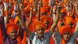 Supporters of the Hindu nationalist Narendra Modi voice their support for him as the prime ministerial candidate for the BJP, at a rally in the Gujarati city of Ahmedabad. Photo: Reuters.