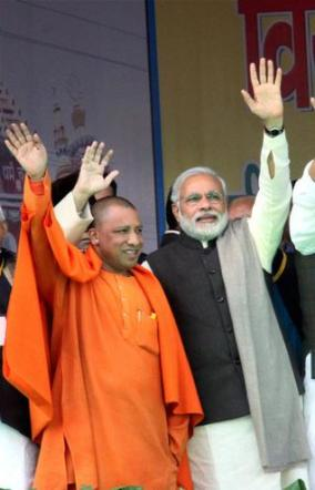 Yogi Adityanath with BJP prime ministerial candidate Narendra Modi recently - Pic. PTI.