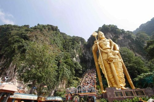 Hindu devotees climb the a 272-step staircase next to the giant statue of Lord Murugan to the Batu Caves temple to complete their pilgrimage during Thaipusam festival outside Kuala Lumpur. — Reuters pic.