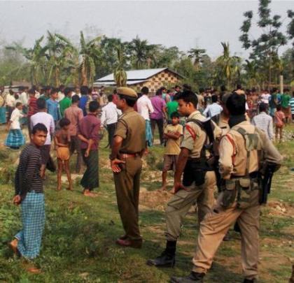 Security personnel at Narsingbari in Baksa district of Assam where some people were killed by militants on Friday. Pic. PTI.