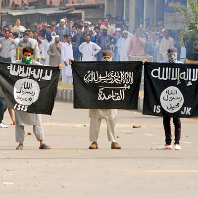 Masked men displaying ISIS and Al Qaeda flags in Srinagar after Eid Namaz on 29 th July, 2014.
