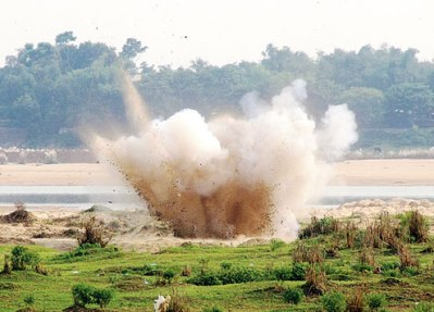 The home-made bombs being detonated on the banks of the Damodar on Friday by Bengal police before central agencies could examine them.  Courtesy: The Telegraph.