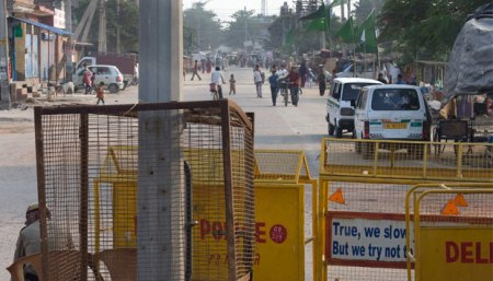 Cops guarding tense JJ Colony in northwest Delhi's Bawana locality. Pic. Naresh Sharma/ Courtesy: Firstpost