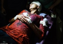 2624657800000578-2971508-Survivor_Rafida_Ahmed_is_pictured_above_being_stretchered_to_hos-a-56_1425059963361