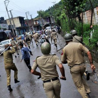 Muslim Fundamentals clashed with Police as usual. Police chase away protesters during clash in Rajouri on Tuesday. Pic. PTI