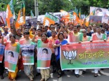 SAFFRON UPSURGE: The Assam unit of the BJP taking out a rally towards Raj Bhawan in Guwahati on Tuesday, protesting against misrule of Congress government in the State. (Sentinel)