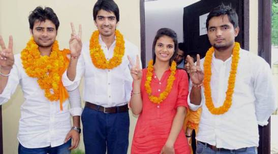New Delhi: ABVP candidates for DUSU elections at Delhi University on Friday. PTI Photo (PTI9_4_2015_000250B)