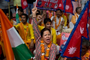 A Nepali woman shouts slogans during a protest against the Nepali government and demanding it be restored as a Hindu nation, in New Delhi, India on Tuesday, September 22, 2015. Photo: AP