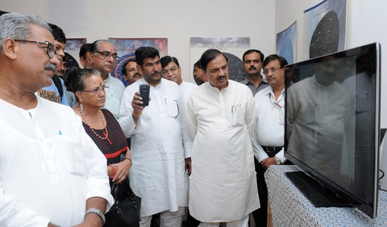 "The Minister of State for Culture (Independent Charge), Tourism (Independent Charge) and Civil Aviation, Dr. Mahesh Sharma visiting the Unique Exhibition on ""Cultural Continuity from Rigveda to Robotics"", in New Delhi on September 17, 2015. The President, CICD, Dr. Sonal Mansingh is also seen."