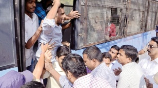 Police arresting students as they took out a rally in support of Beef Festival at Osmania University Campus in Hyderabad on Monday. Courtersy:  Express Photo.