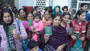 Members of Hindu families who migrated from Pakistan show their Pakistani passports in Jalandhar. They question if citizenship can be granted to Pakistani singer Adnan Sami, why not them. Tribune Photo: Malkiat Singh