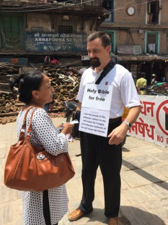 A Swiss missionary talks to a Nepali woman about the Bible in Kathmandu's old city.
