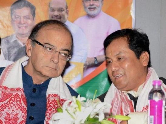 Union Finance Minister Arun Jaitley and BJP's CM candidate Sarbananda Sonowal during the release of Assam Vision Document in Guwahati on Friday. Pic. PTI.