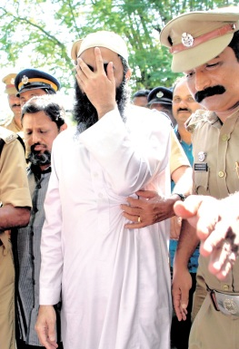 Arshi Qureshi and Rizwan Khan, who were arrested for their alleged link with the terror outfit Islamic State, being brought to the court in Ernakulam on Monday | K SHIJITH- Express Photo.