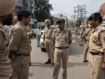 DGP Suresh Arora with police officials at the crime spot in Jalandhar on Sunday. HT Photo.