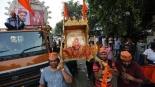 Worshippers carry an idol of Ganesha ahead of Ganesh Chaturthi festival in Ahmadabad, India, Saturday. The ten-day long Ganesha festival begins on Sept. 5. (Photo|AP)