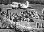 Refugees awaiting evaciation by IAF Dakota in Poonch airstrip, 1947. [Photo: Wikimedia]