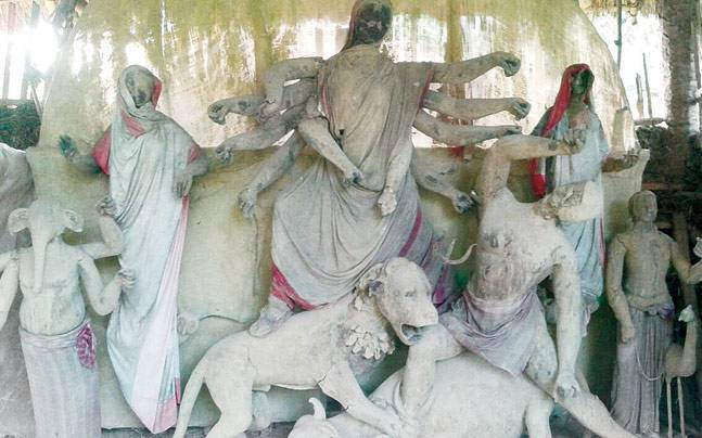 Half-done idols lie at a temporary mud structure in the village of Kanglapahadi in West Bengal's Birbhum district.