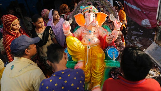 Indians carry an idol of elephant headed Hindu god Ganesha on the eve of Ganesh Chaturthi festival in Ahmadabad, India, Sunday, Sept. 4, 2016. The idol will be immersed in water bodies after worship at the end of the festival. (Photo|AP)