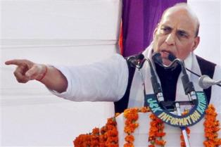 Union home minister Rajnath Singh addresses during a function to honour the families of martyrs of security forces at Kathua, 80 km from Jammu on Sunday. Photo: PTI.