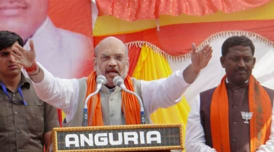 Azamgarh: BJP National President Amit Shah addressing an election rally in Azamgarh on Wednesday. PTI Photo(PTI2_22_2017_000215B)