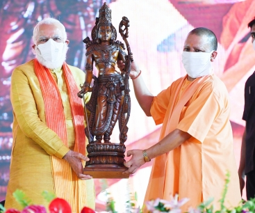 """Ayodhya: Uttar Pradesh Chief Minister Yogi Adityanath presents an idol of Lord Ram as a memento to honour Prime Minister Narendra Modi during the """"bhumi pujan"""" ceremony at the Ram Janmabhoomi site in Ayodhya on Aug 5, 2020. (Photo: IANS)"""